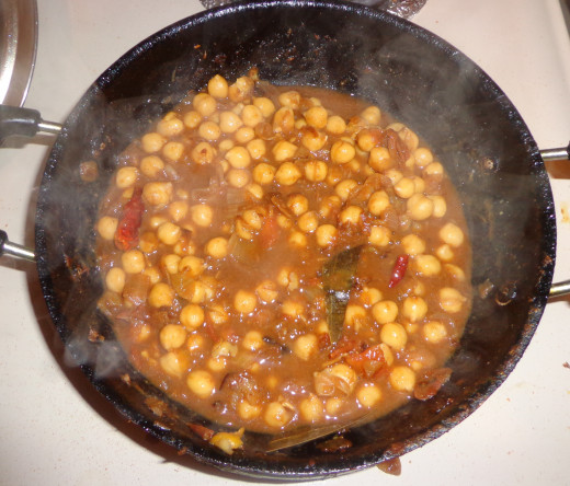 Cooked channa is added in the pan