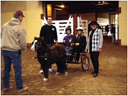 Headers (trained horse handlers) and spotters must attend additional training. It is necessary to have operating knowledge of all securing mechanisms and be familiar with loading and unloading procedures.  Photo taken at Riding Unlimited.