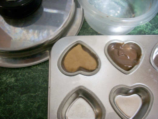Adding the Peanut Butter Hearts to the Carob Mixture