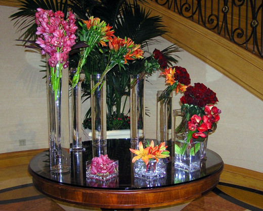 You can have a flower arrangement on a whole table. All you need to do, is work with different flower vase sizes and also different types of flowers.