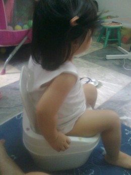 My daughter Yna pretending to go potty