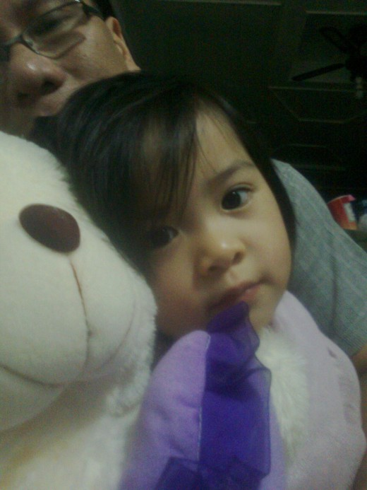 Yna with daddy and her teddy bear while going potty.