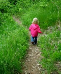 Cute little girl on walking path