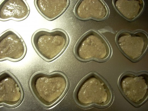 Molding the Coconut Butter and Cinnamon Valentine's Heart Candies
