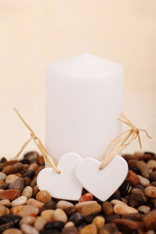 3. Place a simple white candle in the middle of the table in a bed of coloured stones.  Place some heart shaped decorations around it.