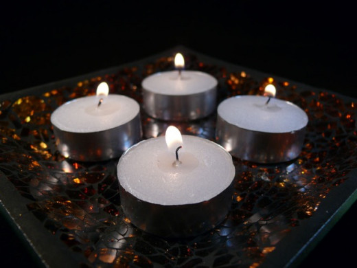 4. Four candles in the centre of the table on a lovely plate can look just fantastic.