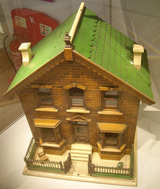A 19th century doll's house. The outside detail is very exact.