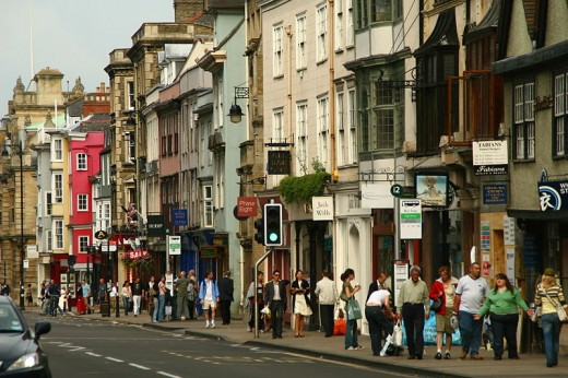 Busy retail shopping street in Oxford, UK.