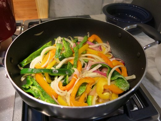 Stir fry peppers & onions on high heat