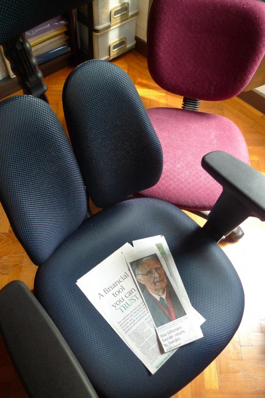 An ergonomic chair and a common executive swivel comfy