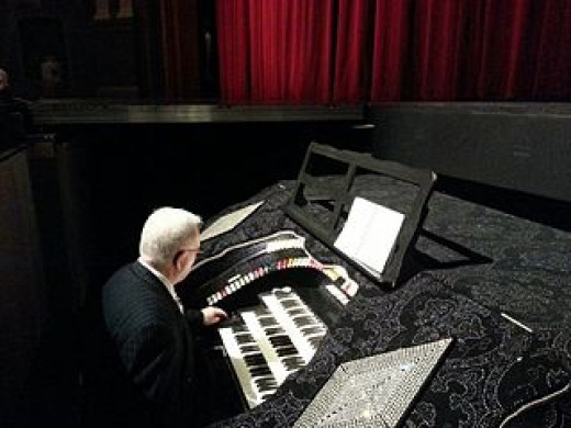 Rhinestones can be glued ANYWHERE, including this theater organ console.