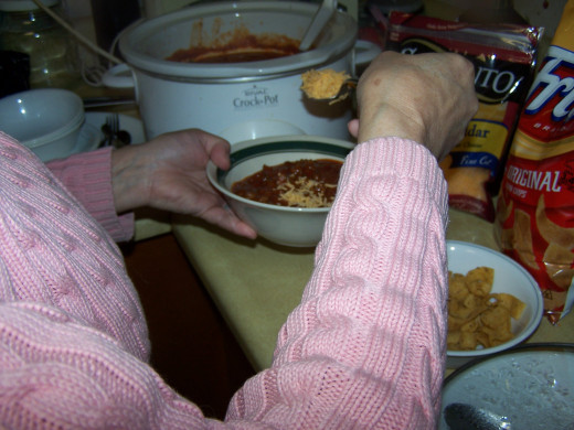 My wife preparing her chili to have for dinner.