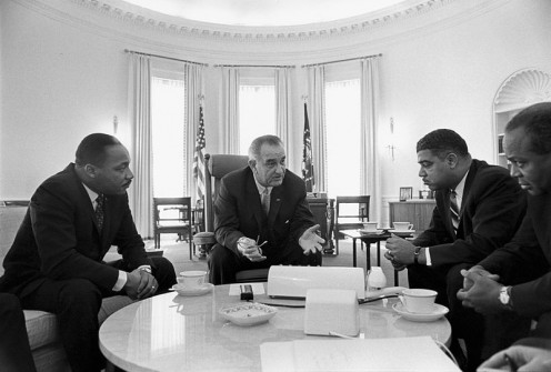 January 18th, 1964.  President Lyndon B. Johnson is meeting with civil rights leaders, including James Farmer, Whitney Young, and Martin Luther King Jr. In the Public domain, and credit to Yoichi R. Okamoto.