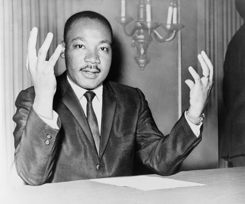 Martin Luther King Jr. during a press conference.  Taken November 6, 1964, by Dick DeMarisco and in the public domain.