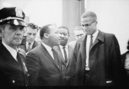 Martin Luther King Jr. and Malcolm X waiting for a press conference, taken March 26, 1964 by Marion S. Trikosko, and in the public domain.