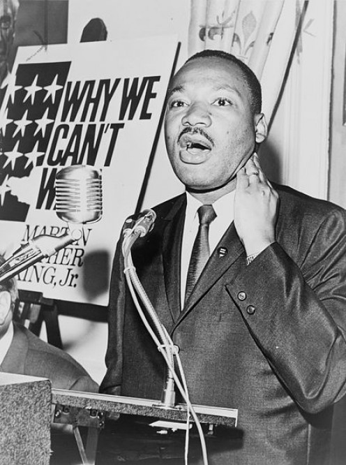 Martin Luther King Jr, photo taken on June 8, 1964.  He is at a press conference, and photo is taken by photo by Walter Albertin, and in the public domain.