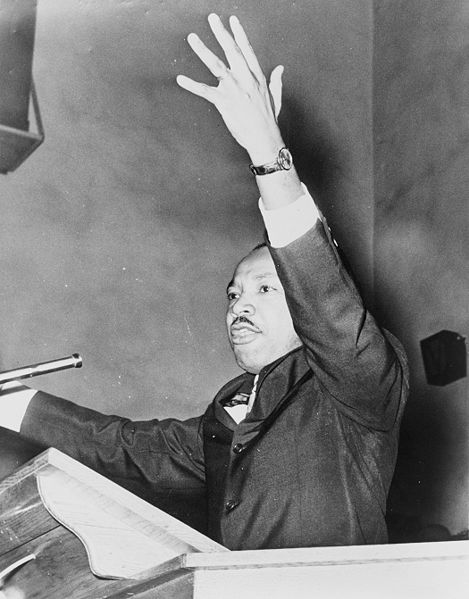 Martin Luther King Jr. at a freedom rally.  Located at Washington Temple Church.  Photo taken by O. Fernandez, and in the public domain.