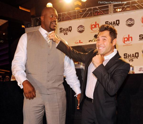 Oscar De La Hoya, seen here with Shaquille O' Neil, is a mainstream celebrity who has his own boxing promotional company.