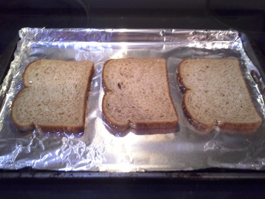 Step Two: Lay out your bread on your cookie sheet; I can usually make up to six pieces at a time