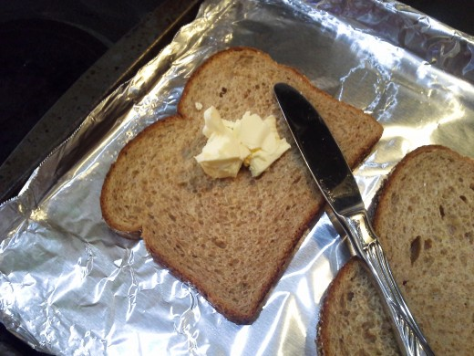 Step Three: Spread a thick layer of butter on each piece of bread
