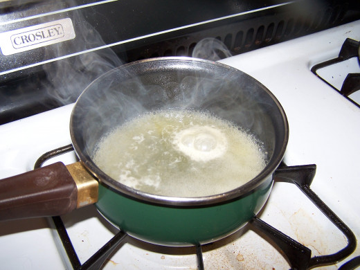 Boiling the gibletsand neck to make broth. I set the liver aside to make Rumaki.