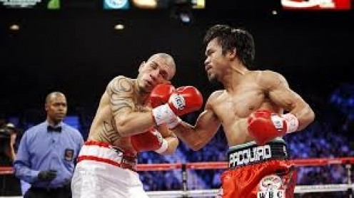 Manny Pacquiao knocked out Miguel Cotto in a welterweight title bout. The two warriors engaged in a grueling contest until Manny broke Cotto down in the late rounds.