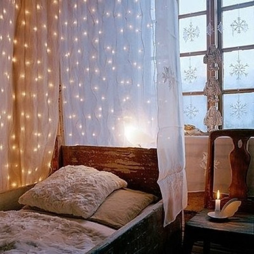 Try hanging string lights behind fabric