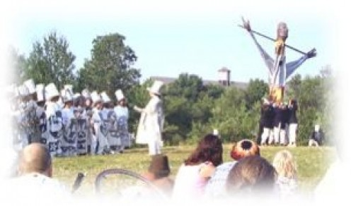 A shot from a Bread and Puppet show
