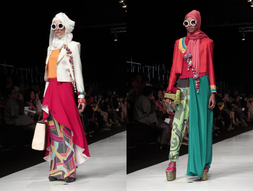 Models unveil designs from the Dian Pelangi ensemble for Indonesia's Jakarta Fashion Week 2014