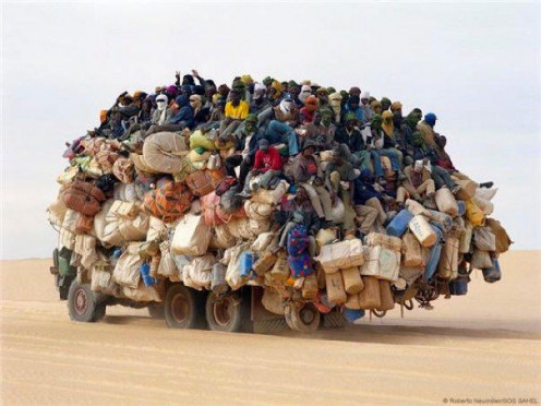 In this picture, one sees a lorry carrying goods and people. It was taken in the Sahara Desert. These people look at the desert as an opportunity. It has never got in their way of life.