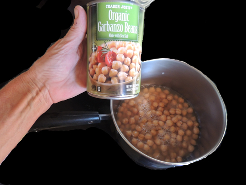 meanwhile, warm the garbanzos beans. Heat breaks down some of the fibers in the bean, so this step is essential for quality control