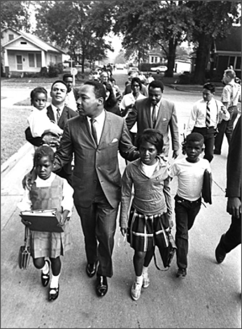 Martin Luther King, Jr. leading children, 1963
