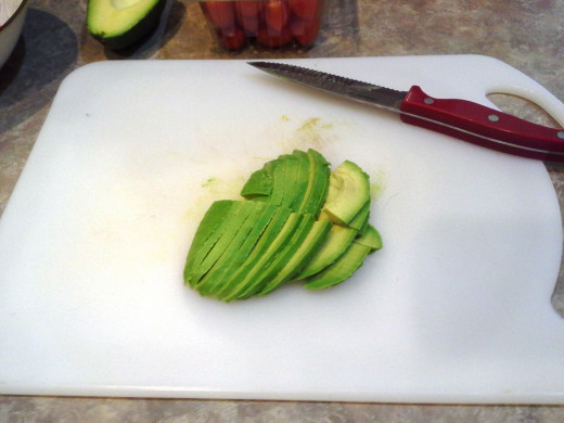 Step Six: Now cut, de-seed, peel, and slice your avocado