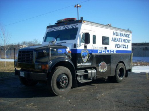 """Even California's Nuisance Abatement teams show up in armored """"swat"""" vehicles."""