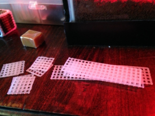 Pieces to my butter toy, stacked neatly and by size.  The extra four square pieces were for the pats of butter on the end.