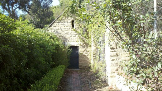 The walkway to the Gardners Shed at Greystone Mansion.