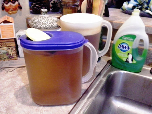 Step Seven: Cover with the pitcher tops while brewing