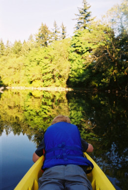 My son in the bow of my kayak as we explore the Tualatin River.