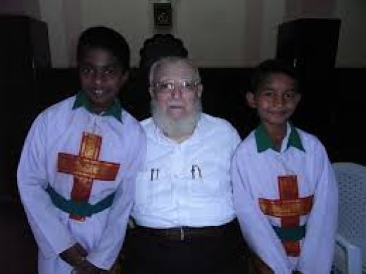 White Missionary with converts