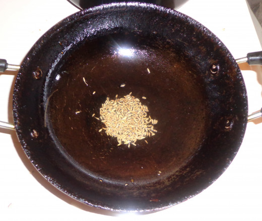 Cumin seeds are added in the oil