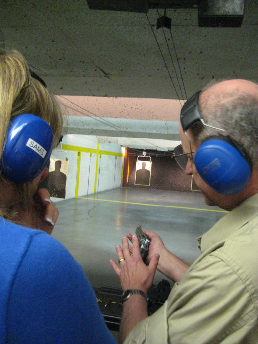 Cyndy is introduced to the .22 rimfire revolver.