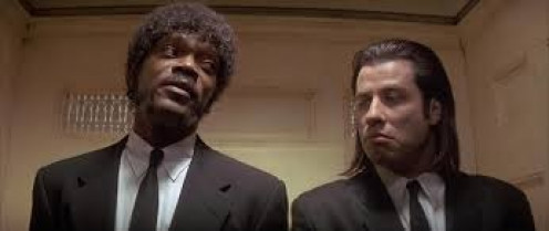 Samuel Jackson and John Travolta starred in the movie Pulp Fiction. Also, Ving Rhames played as their gangster boss.
