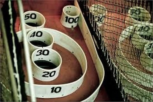 Skee Ball is very popular in video arcades all over the globe. It's like a hip version of bowling if you will.  These contraptions come in smaller sizes for home use as well.