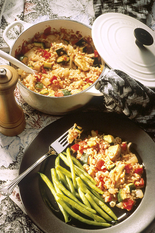 Casserole cooking helps keep your oven clean. A casserole of chicken and rice in a pot.
