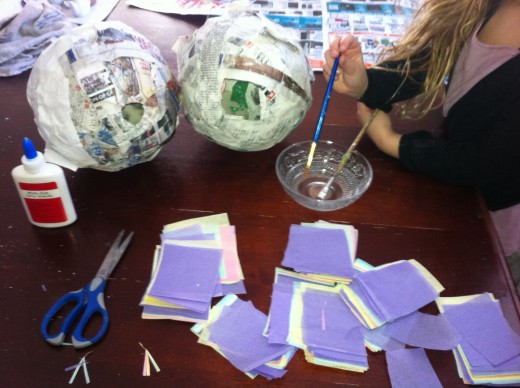 Be sure to use tissue paper that is cute in squares and paint the glue on piñata. As an added security that the tissue won't fall off dip scrunched tissue paper squares in the glue them stick them to the piñata. Designs are endless
