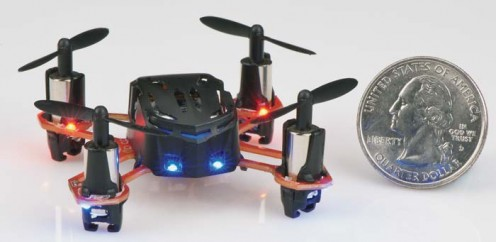 The quadcopter compared in size to a regulation size United States quarter.