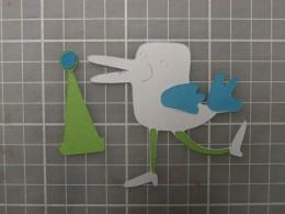 PomPom adhered to Hat  Legs adhered to Bird