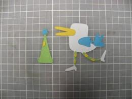 Decorations adhered to Legs and Hat Beak adhered to Bird