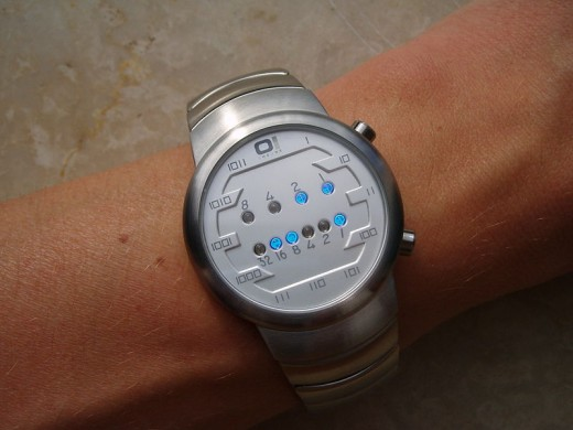 A Binary Watch.  The top line is the hours - 3. The bottom the minutes - 25.  The time is therefore 3:25.