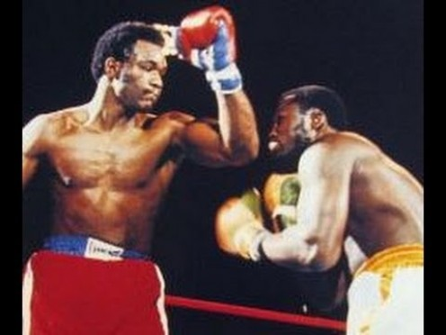 George Foreman knocked Joe Frazier down six times in two rounds to win the heavyweight championship.